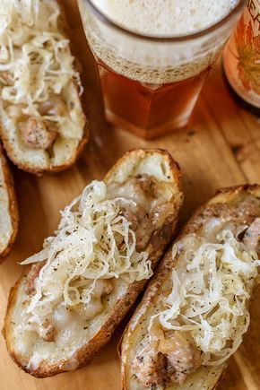 Oktoberfest Potato Skins ~ Delicious russet potato skins stuffed with Bratwurst sausage, beer-caramelized onions, melted gruyere and white cheddar cheese blend, and topped with sauerkraut! Oktoberfest Party, Oktoberfest Recipes, Bratwurst Sausage, Beer Bratwurst, Sausages, German Bratwurst, Bratwurst Recipes, Beer Recipes, Cooking Recipes