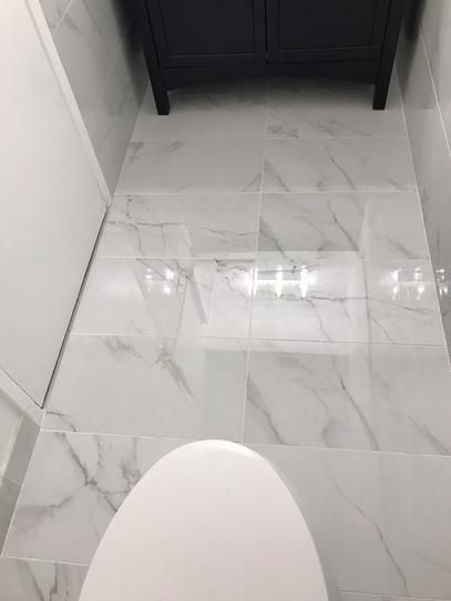 Msi Carrara 12 In X 24 In Polished Porcelain Floor And Wall Tile 16 Sq Ft Housing In 2020 Porcelain Flooring Modern Floor Tiles Marble Bathroom Floor