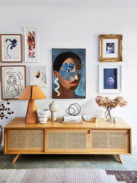 cane credenza styling // living room art ideas Kerrie-Ann Jones' home is a light-filled space that blends mid-century furniture with contemporary art in a palette of whites, grays, and rust.