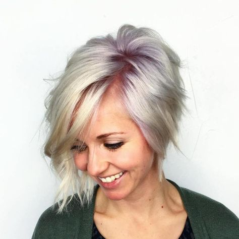 #16: Asymmetrical Wavy Bob Umm…yes! An asymmetrical cropped cut with spiral curls and choppy layers wins every time. But when you add cool purple roots and platinum ends? Well, that just takes the haircut to a whole other level. Trust us, you will have so much fun styling these layers every morning!
