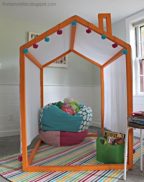 How to make this DIY minimalist playhouse for kids - like a tall tent with just enough privacy. via That's My Letter and Ana White