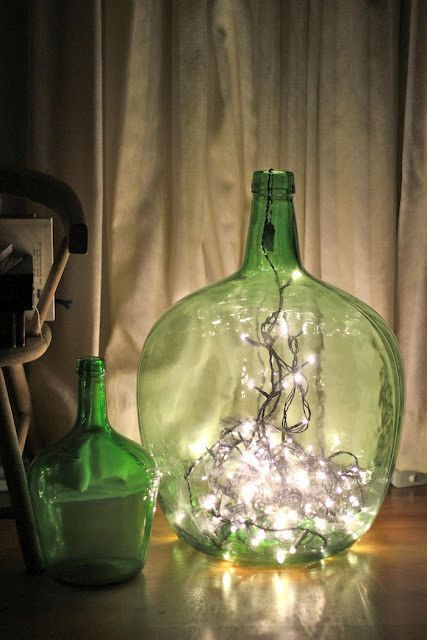 Display string lights in glass containers for a festive DIY lamp.