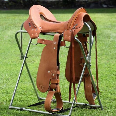 This New Model Treed Saddle is Built on a new wooden tree, Narrow gullet. Premier quality leather. Sizes: 14 to 17. IT IS BEST TO CALL US WHEN YOU ARE READY TO ORDER.