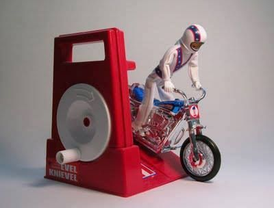 Evel Knievel Stunt Cycle I don't remember what year I got this, but damn it was awesome. You'd crank the wheel to generate power and let him rip. Remember the Evel Knievel Scramble Van, too?