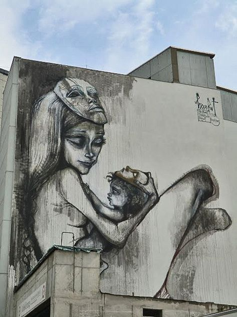 Wall-mural-by-Herakut