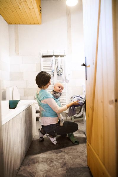 Doing chores while caring for a helpless person - Everything I Won't Miss About Having a Baby - Photos