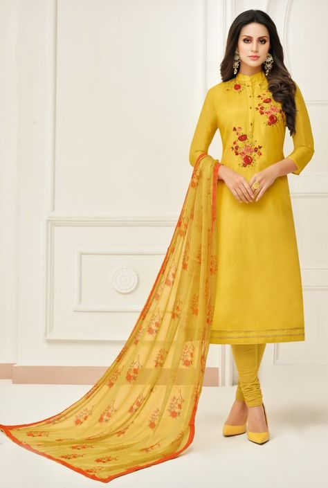 c3245b61dfb7 Include your self in the glamour of the season with this yellow chanderi  cotton churidar suit. The attractive embroidered work a intensive  characteristic of ...