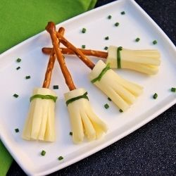 With schools wanting healthy snacks, this is a cute Halloween idea. Pretzel and Cheese Broom Sticks by mjohnmeyer