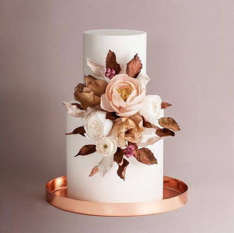 We have no doubt these 28 sugar flower wedding cakes will spark your fancy. We rounded up the best cake designers in the industry to share their past cake designs from real weddings that defy gravity, inspire endlessly and color our hearts happy. Head on to Ruffled now to see this modern wedding trend in action now. #sugarflowers #colorfulweddings #weddingcakes