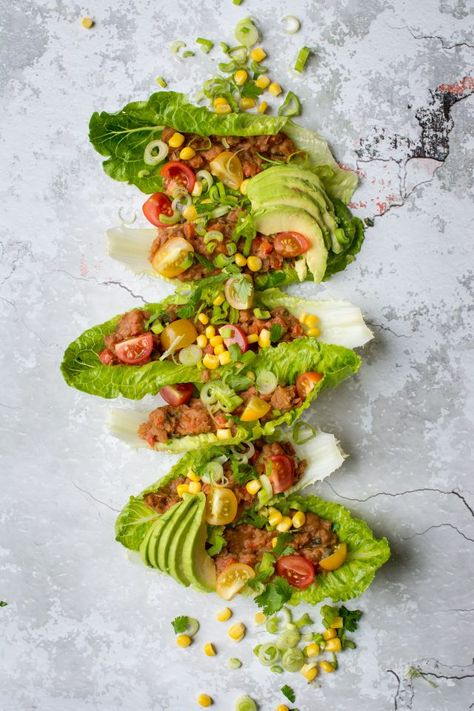 Refried Bean Lettuce wraps, perfect for a vegan lunch on the go, or just a lighter dinner option! Get this super easy recipe here!