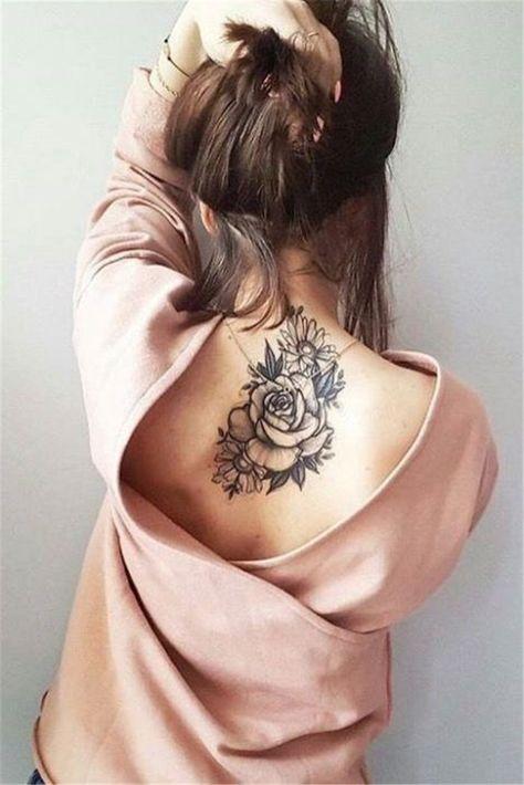 Best Tattoos On The Back That Will Make You Look Stunning; Back Tattoos; Tattoos On The Back; Simple Tattoos; Back tattoos of a woman; Ribbon tattoos; Flower tattoos; Cross tattoos; Little prince tattoos; Symbol tattoo; Pattern tattoos;