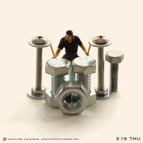 Drummer. Miniature photography = could have drum set up or use the nuts and bolts idea as dj decks set up