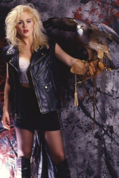 She's just chillin' back in 1988 with some birds of prey and a snake like it ain't no thang.