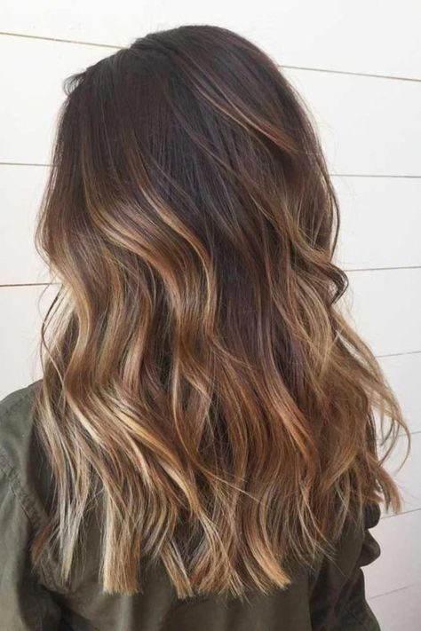 Fantastic brown hair colour on medium length hair! Bronde hair has soared in popularity since Kylie Jenner revealed her hair colour transformation earlier in lockdown. With a light brown base, the beauty entrepreneur has added dimension with a few, strategically placed golden streaks.