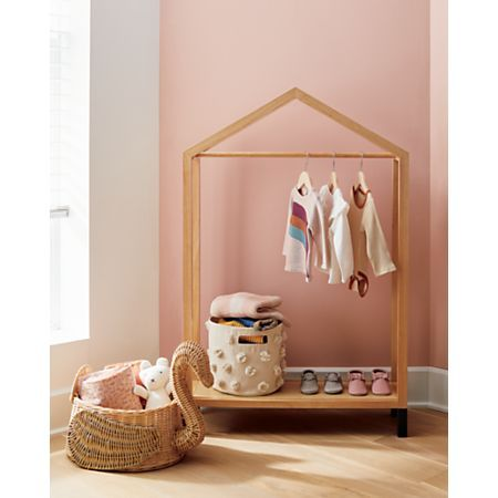 Sale ends soon. Shop Natural and Black House Shaped Garment Rack. Our house-shaped garment rack makes a delightful home for your little one's keepsake clothing. Display your kid's most stylish ensembles and colorful costumes for dress-up time. Big Girl Bedrooms, Girls Bedroom, Kids Clothing Rack, Collapsible Storage Bins, Garment Racks, Rattan Basket, Nursery Neutral, Baby Boutique, Girl Room