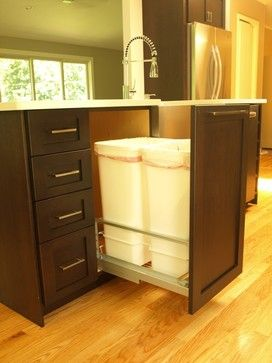 Double garbage pullout with full height door - tropical - kitchen - new york - KraftMaster Renovations