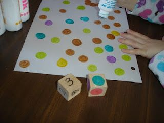What a fun game!  Make two dice: one with numbers, and one with colors.  Roll the dice, then use dot stamps to make that number of dots in that color on your paper.