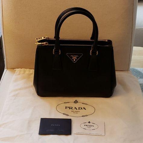 37011d3c18ed Prada saffiano lux double zip tote bag Classic saffiano handbag. Black  leather. Gold hardware