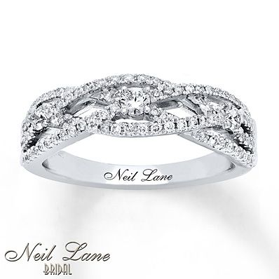 Ribbons of 14K white gold lined with sparkling diamonds weave together to form this show-stopping anniversary band from Neil Lane Bridal®. Totaling 1/2 carat in diamond weight, the ring also features Neil Lane's signature on the inside of the band. Diamond Total Carat Weight may range from .45 - .57 carats.