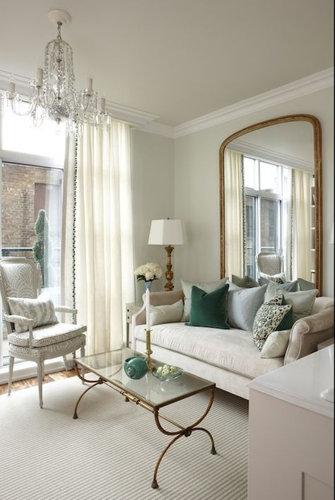 living rooms - Para Paints - Eyelet - Sarah Richardson Nicole Sofa soft green walls pale green ceiling floor length gold mirror green pillows antique brass glass-top coffee table