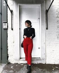 Red pants and black turtleneck