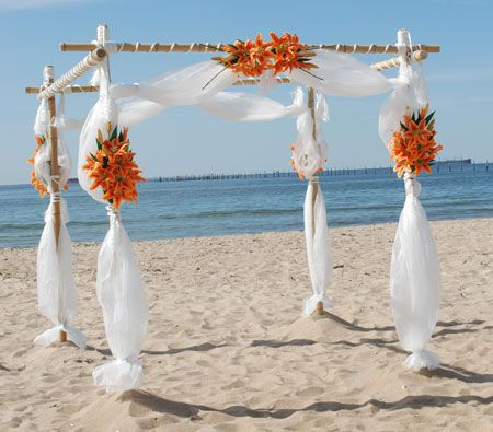 Bamboo Wedding Arch With Tangerine Flowers Simple And Pretty Could Incorporate Crystals Hanging From The As Well
