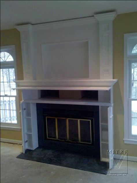 TV framed in over fireplace- recessed area for mounting brackets so it ...