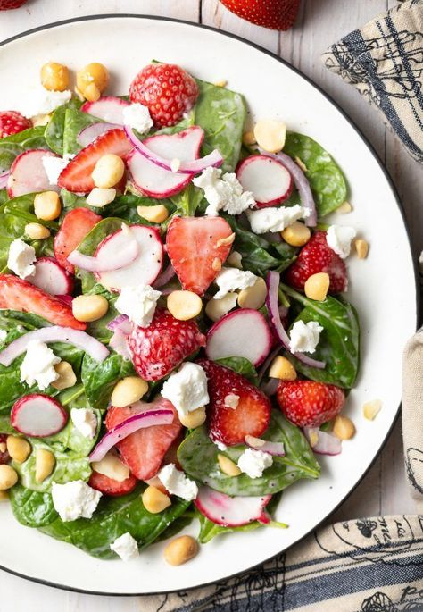 Chunky Strawberry Salad with Poppyseed Dressing - Strawberries are the star of this healthy spinach salad recipe that's loaded with fresh ingredients, crunchy macadamia nuts, and creamy goat cheese. Top with poppyseed dressing and you've got a bright and satisfying summer salad! #aspicyperspective #strawberries #strawberry #salad #poppyseed #dressing #summer #spring #spinachsalad #strawberryseason