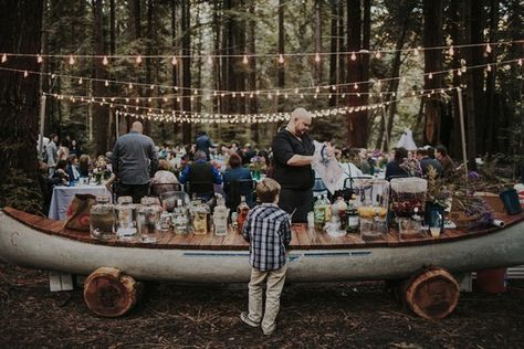 Camp Navarro is the perfect woodland wedding venue for a unique food display like this canoe! Photo: Tyler Branch