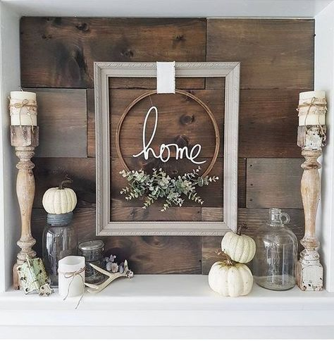 a cool frame and embroidery hoop wreath, some pumpkins, antlers and candles for a modern rustic space