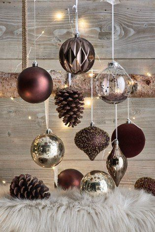 Enliven your holiday decoration with this natural 12 pack luxury baubles.