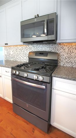 GE Slate Appliances. Just Got These For Our New Kitchen And I LOVE Them!  Looks Way Better Than Stainless Steel And Seriously... NO Fingerprints!