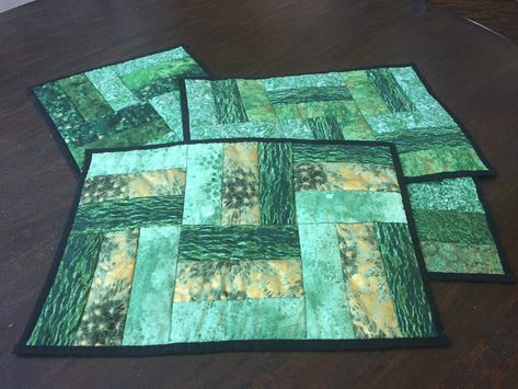 Jelly roll Place mats. Each one is a little different, but super easy and quick. Entire project made for less than $20