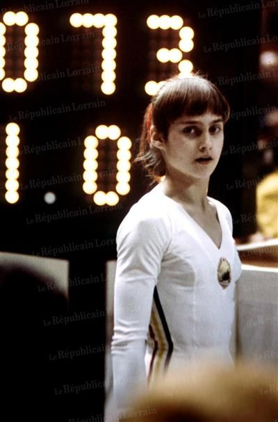 Nadia Comaneci the Perfect 10, Summer Olympics 1976, Montreal. First female gymnast to ever be awarded a perfect score of 10 in an Olympic gymnastic event. The scoreboard wasn't set up to record a 10 so it read 1.0