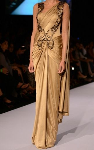 Amit Aggarwal created this Gold pre-draped saree for his Winter/Festive 2013 collection. However, avoid a pre-draped saree as it isn't versatile like a regular saree. Ask Urban Pari for pure Georgette Gold saree.