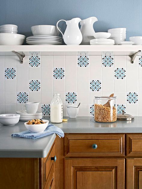 Backsplash - Peel-and-Stick - For a super-simple backsplash design, use white ceramic tiles and apply peel-and-stick decals to specific tiles. Create a pattern with the decals or place them randomly for a casual eclectic vibe.