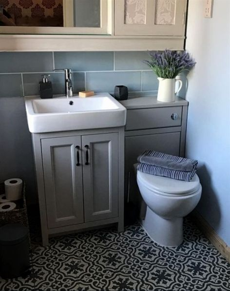 The Grey Bathroom Furniture In This Small Bathroom Creates A