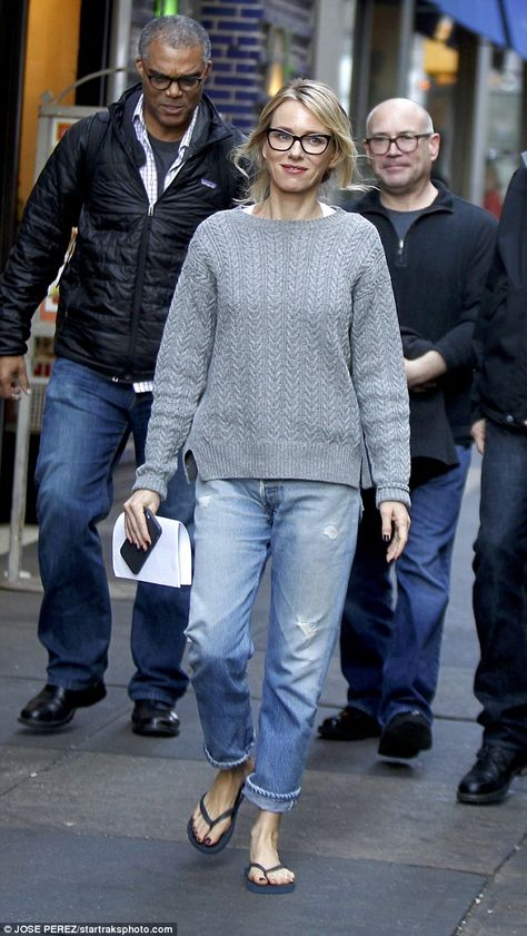 Geek chic!The mother-of-two's slender figure was kept under wraps in a pair of cuffed boy...