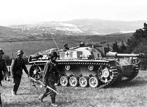 Stug III AusF and soldier carrying a captured SVT 40