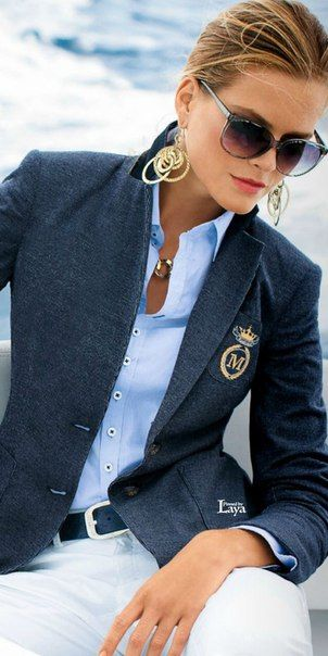 A navy jacket embellished with a crest lends an air of authority to a basic outfit.