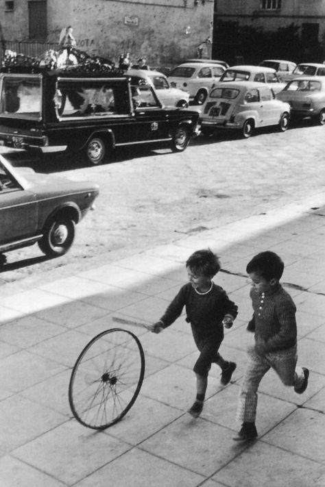 ~~ I love how life and death pass each other by ~~ Hoop rolling in Palermo, Italy (1971) • photo: Henri Cartier-Bresson