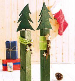 Wissen Sie schon vom neusten Bastel-Trend diesen Winter? Holzpfosten mit Scherenschnitten sind der Renner, erst Recht mit solchen süßen Weihnachtsbäumen!