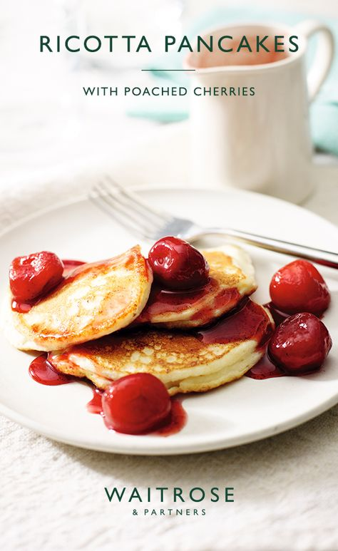 These light and fluffy ricotta pancakes are topped with juicy cherries poached in a citrussy, vanilla syrup.     Tap for the full Waitrose  Partners recipe.