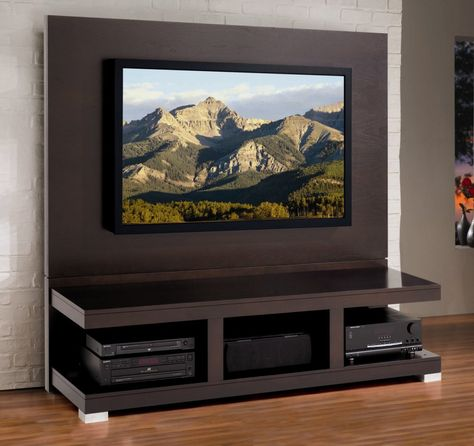 Simple Black TV Wall Panel Design Idea with Open Shelves, Large Television, and Brown Hardwood Floor Tile