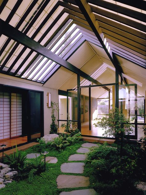 Joseph Eichler Homes: Outstanding Atriums. Raise the ceiling, put in some large potted trees, 3-5 small birds flapping about, and boom, you have my dream sunroom/back door.