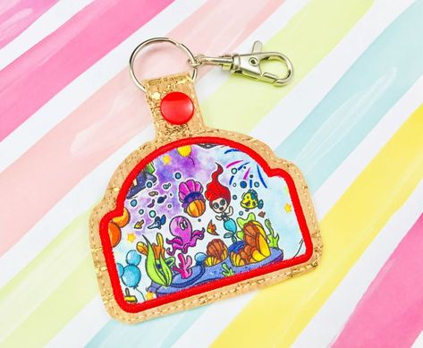 Abstract applique snap tab ith embroidery designs snap tabs