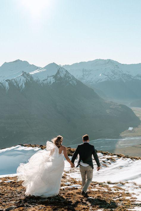 Wanaka really has the ability to have stunning Weddings all year round, from Summer to Winter you are completely covered // #sayidoinwanaka #wanakaweddingcollective #tregold #tregoldweddings #lakewanaka #2021 #alternativewedding #bestnewzealand #bohowedding #bridalfashion #bridegroom #destinationnz #elopement #epicmountains #nzmustdo #outdoorwedding #realweddings #summerwedding #wedding #weddinginspo #weddingseason #love #beautiful #bridal #bride #weddinginspiration #weddingplanning