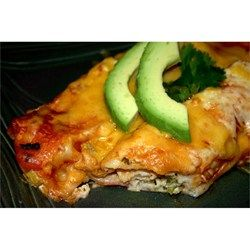 The filling for these enchiladas combines halibut with green onion, bell pepper, cilantro, sour cream, mayonnaise, and Cheddar cheese.
