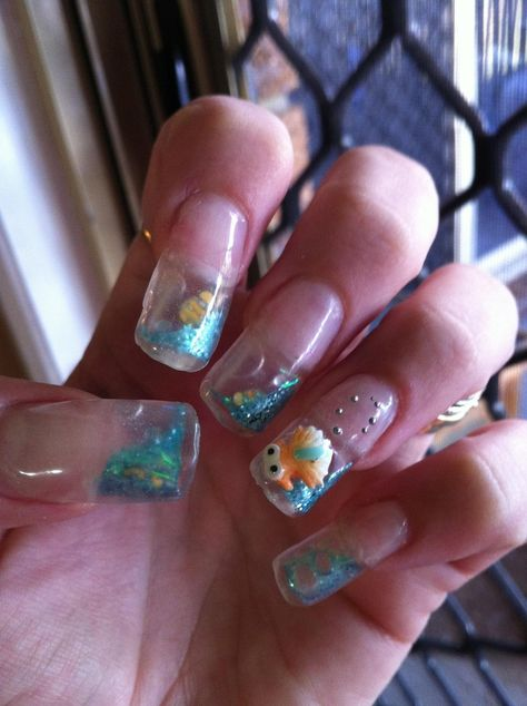 As creepy as I find fake nails, these are clever. water/aquarium/snow globe nails