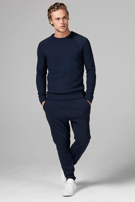 OUTSTANDING SOFT QUALITY, BRUSHED FRENCH TERRY SWEATSHIRT IN NAVY COLOR. SLIM FIT PULLOVER . ROUND NECKLINE SHAPE. CUFF AND HEM BAND DETAIL W/ STITCHING. CONTENT: 50%POLY/ 46%COTTON/ 4%RAYON CARE: MACHINE WASH, COLD DELICATE CYCLE, DO NOT BLEACH, LAY FLAT TO DRY, COOL IRON IF NEEDED, DO NOT DRY CLEAN. PRE-WASHED FOR SHRINKAGE. SIZE: MALE MODEL IS 6' WAIST 31 AND WEARS A SIZE M male MODEL IS 5'11 WAIST 25 AND WEARS A SIZE XS Made in Los Angeles, California